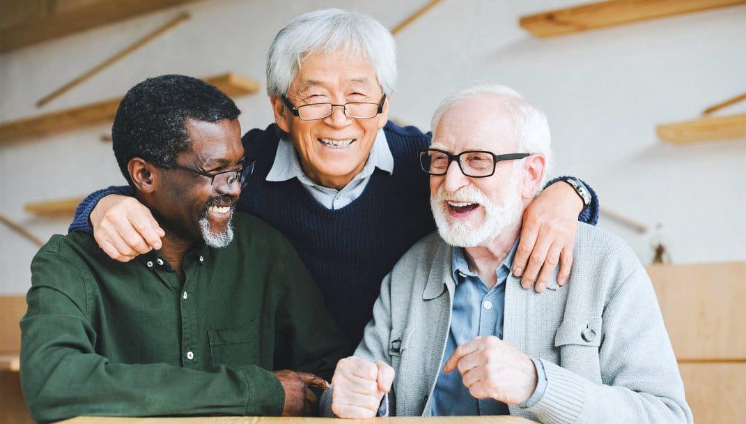 three elderly smiling